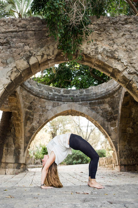 A portrait of a woman doing yoga poses outdoors - sports photography tips