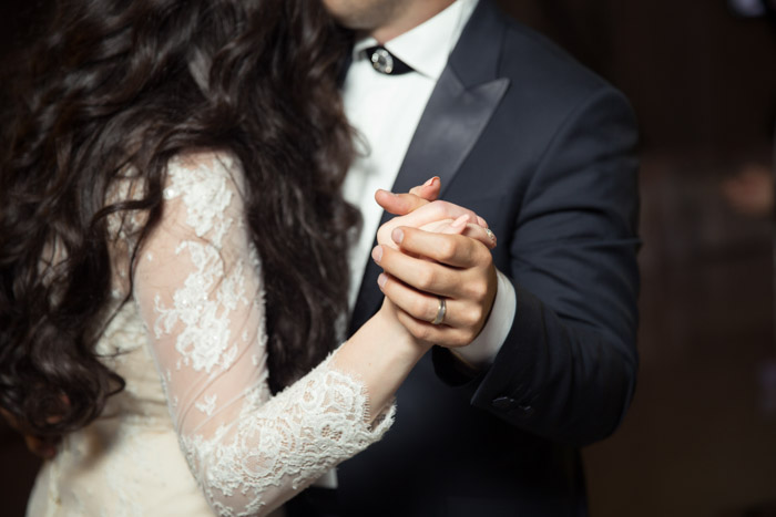 A close up stock photo of a newlywed couple dancing