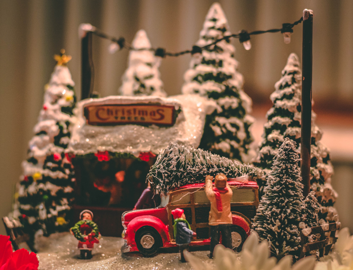Christmas themed stock photography of miniature people and Christmas trees