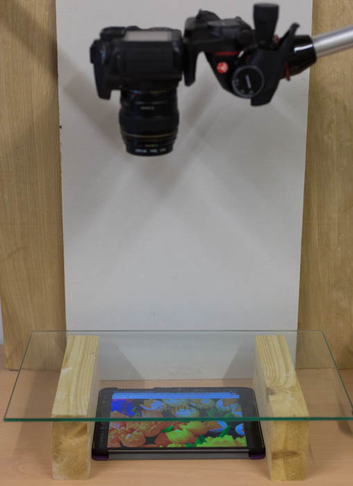 A camera capturing a tablet with a photo of tulips