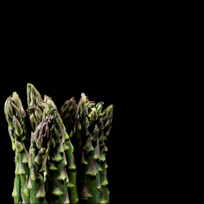 Asparagus in front of a black background