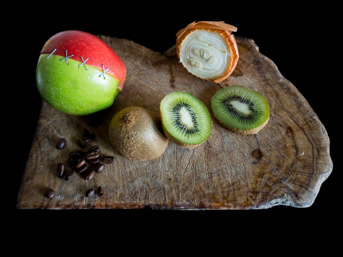 Kiwi, onion, coffee and two half apples sewed together on a wooden plate - Macro photography tips