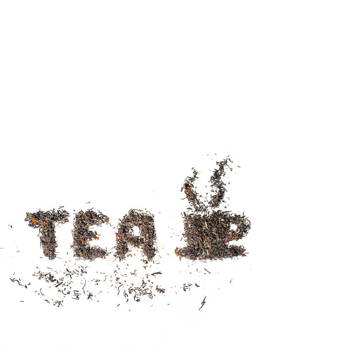 The word tea written in tea leaves and a cup drawn with tea leaves