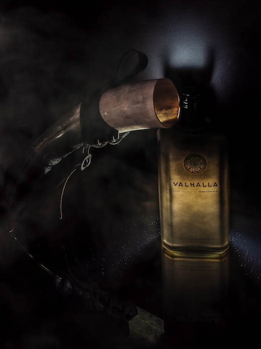 Atmospheric photo of a bottle of Finnish liquor beside a viking horn