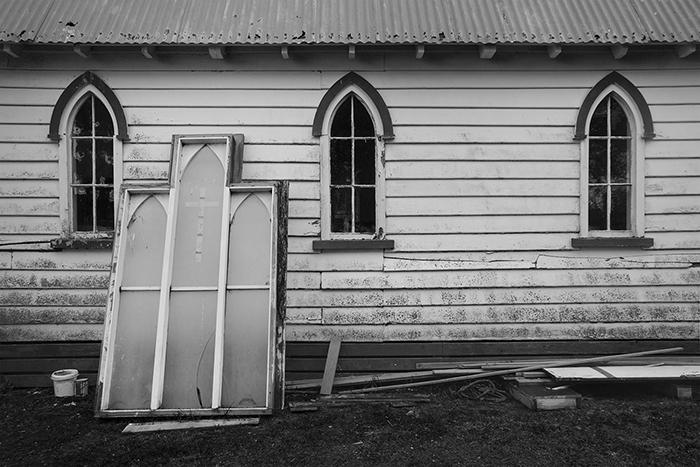 black and white documentary photography of Whare Karakia church awaiting repairs