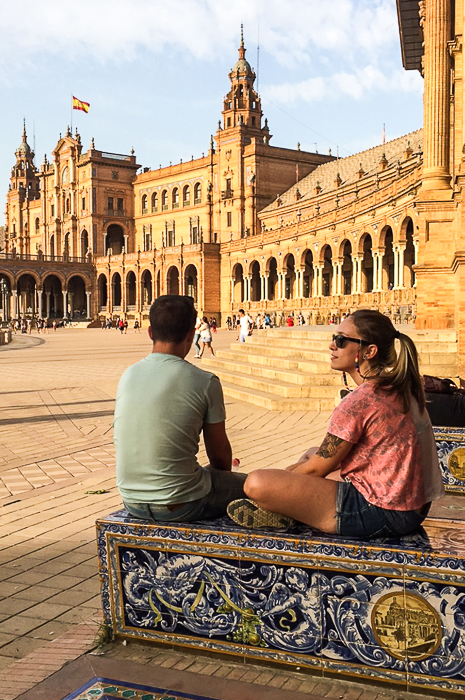A couple relaxing outside a famous building