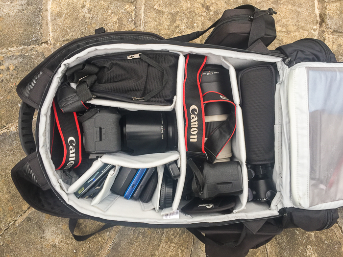 camera pack with 2 canon camera, lenses and other equipment - a mistake for travel photographers is packing too much gear
