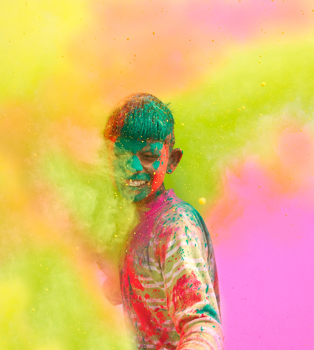 A colourful photograph of a young boy painted for a celebration