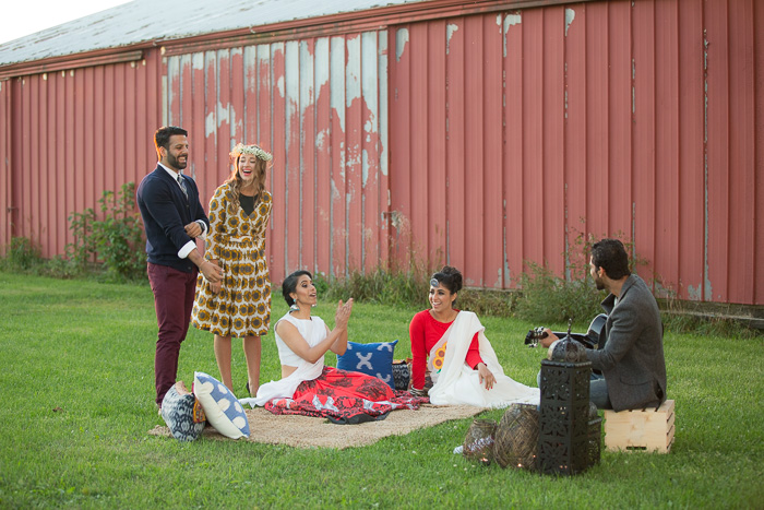 A lifestyle photography fashion shoot involving a styled outdoor picnic with two men and three women in Indian-Fusion outfits and accessories.