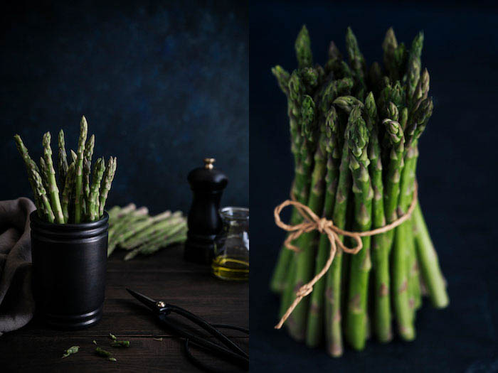 food photography of a bunch of asparagus on a dark background