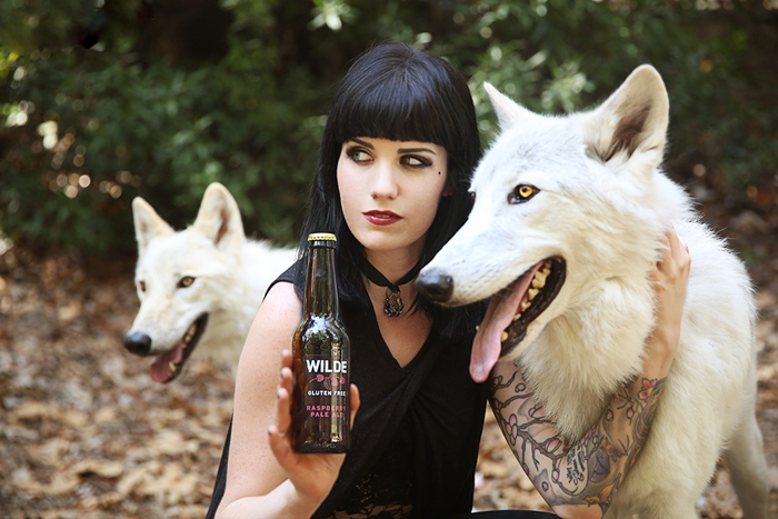 product photography of gluten free beer with a model and two wolfdogs