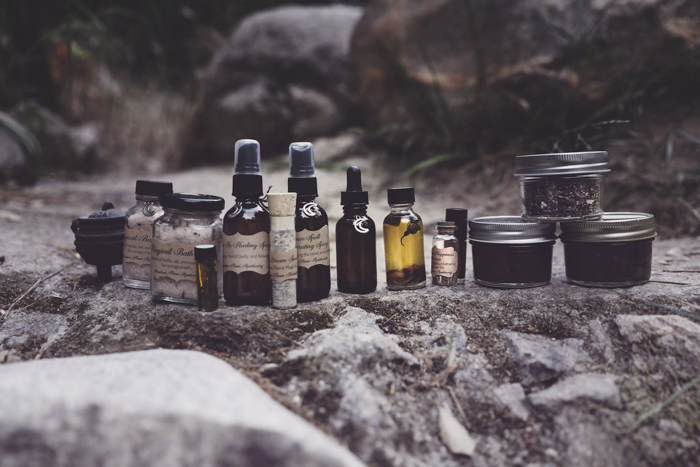 creative product photography of beauty products lined up on a rock