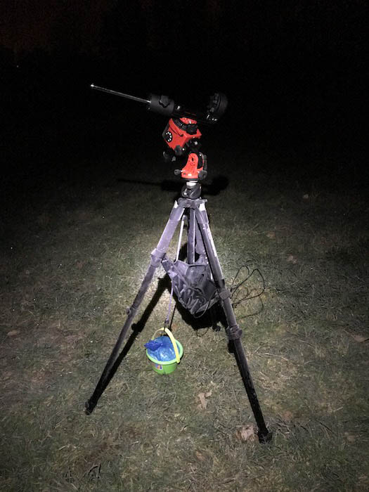 SkyWatcher Star Adventurer with a tripod and child's play bucket to weigh it down