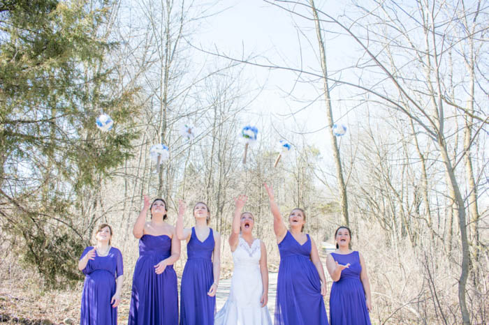 bride and bridesmaids tossing their bouquets in the air, wedding photography