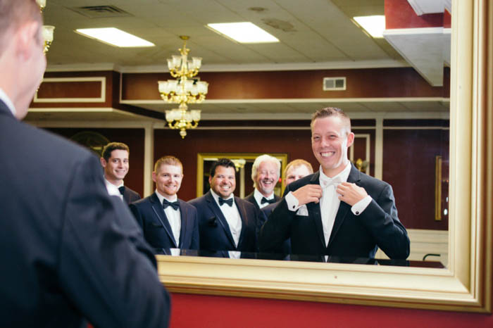 groom and groomsmen photographed in a mirror