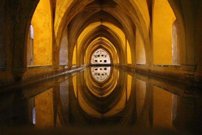 Interior shot of the corridor at Royal Alcázar of Seville, Spain