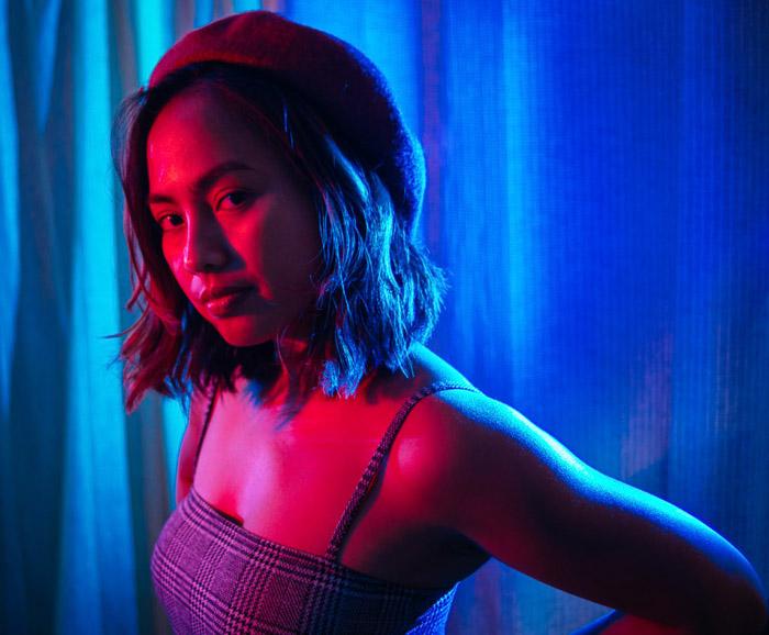Female model lit with color gel lighting