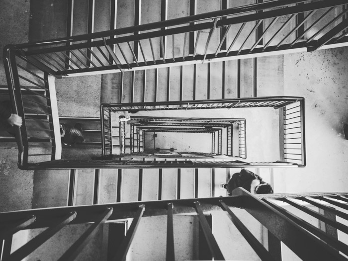 Overhead view of a winding staircase in a multifloored building