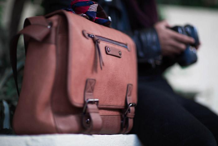 A diy photography camera bag beside a person