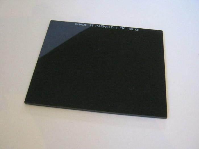 Um vidro de solda usado como filtro de densidade neutra para fotografia DIY