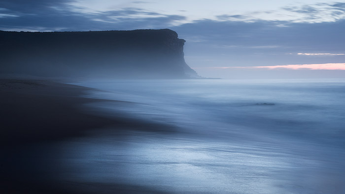 mid range shot of a dramatically moody coastal seascape, shot with a Nikon 50/1.8 D lens
