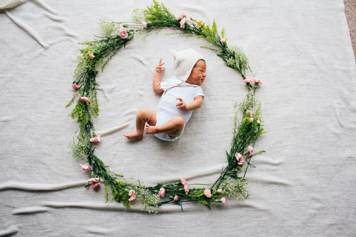 Using a flower wreath is a great way to capture newborn photography subjects