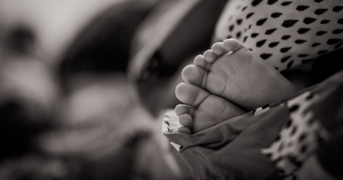 A smartphone will allow you to get close, capturing those small details in your newborn photography