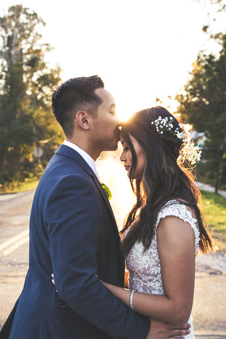Wedding portrait of the couple embracing outdoors