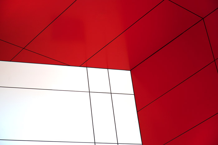 Close up architectural photography showing red and white lines. Abstract photography ideas.