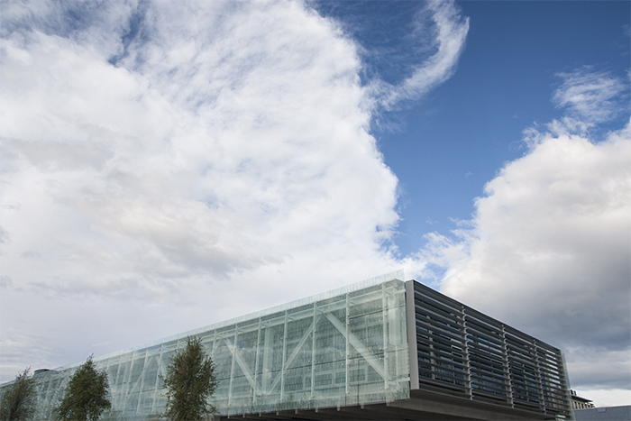 A photo of The rooftop of University of Canterbury ICT Building, New Zealand, most of the frame taken up by a cloudy blue sky