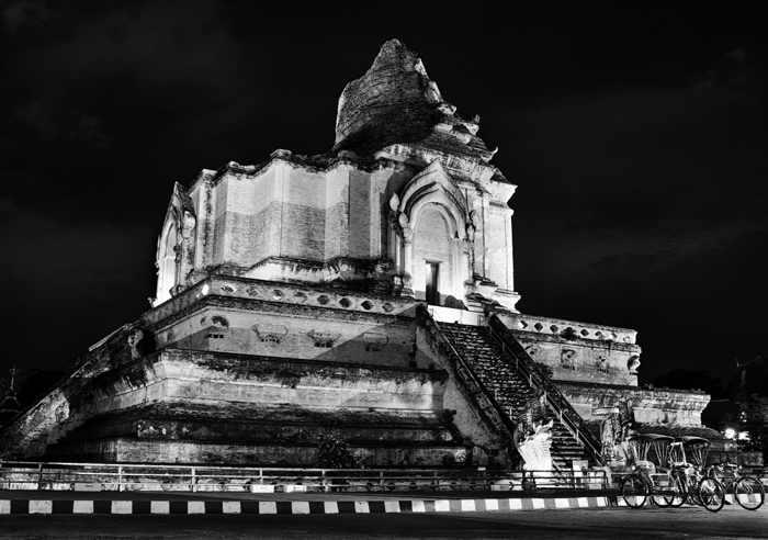 Black and white travel photography of Chiang Mai's Wat Chedi Luang at night.