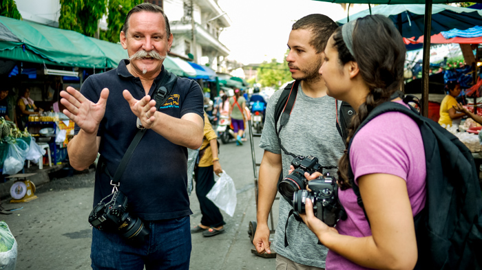 Documentary photography portrait of a photography workshop in a Market in Chiang Mai, Thailand.