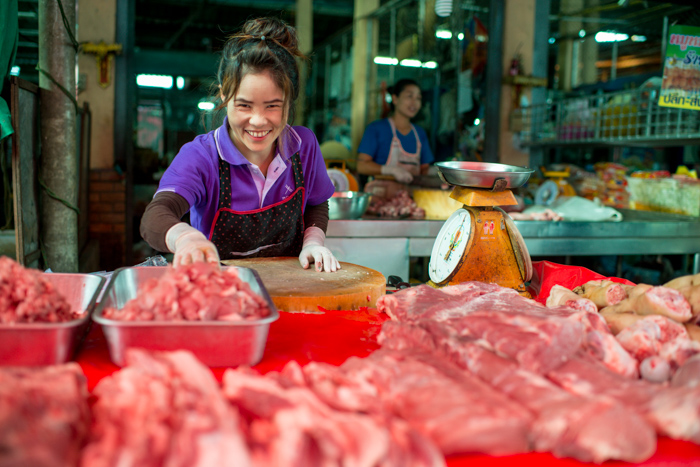 Lady in a market selling meat
