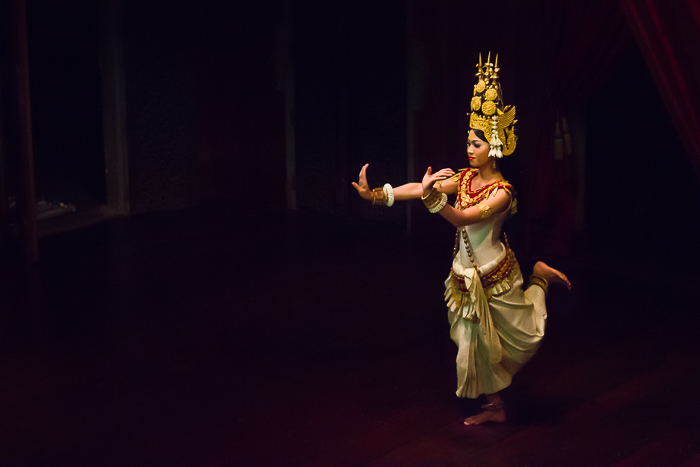 Atmospheric travel photography of a girl dancing in a dimly lit room