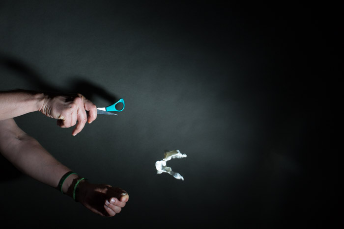 A photograph of a hands popping balloons to activate a MIOPS Smart Trigger - 2 Seconds - f/10 - ISO 100