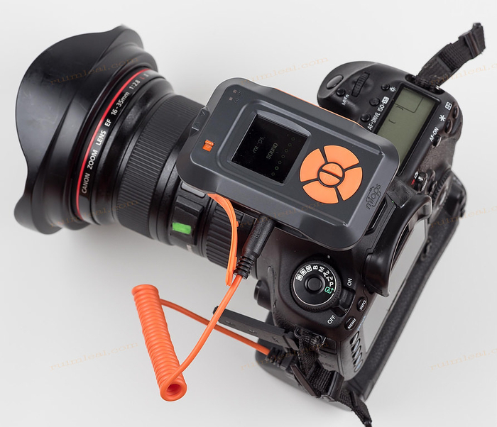 Image of a SLR camera fitted with MIOPS Smart Trigger on white background