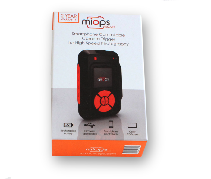 Image of a MIOPS Smart Trigger in its box on white background