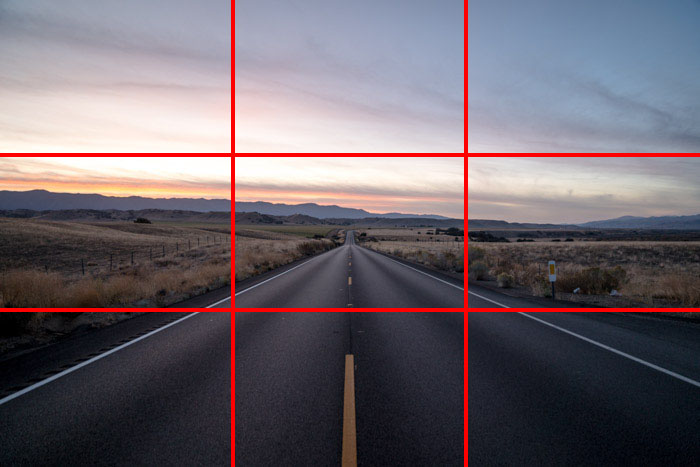 A countryside road scene at evening time, with the rule of thirds grid overlayed