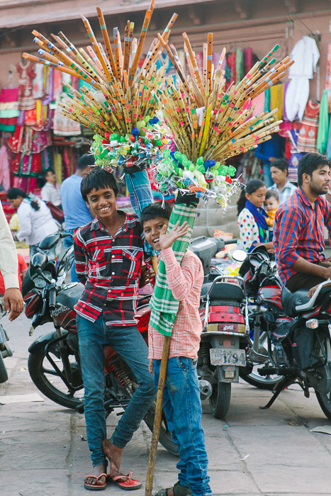 Travel photography of two boys smiling at the camera in India.