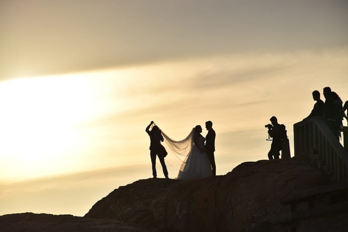 Dreamy evening photo of a wedding party outdoors at sunset