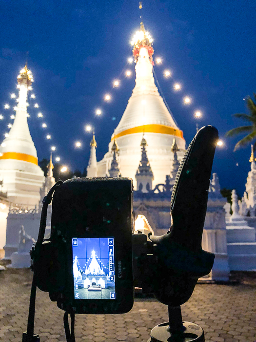 Setting up a camera on a tripod for blue hour photography
