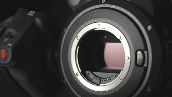 Close up of a camera body without lens. Buying used lenses and used cameras.