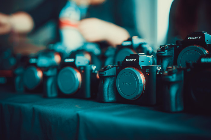 Photo of a a line of Sony cameras. Buying used lenses and used cameras.