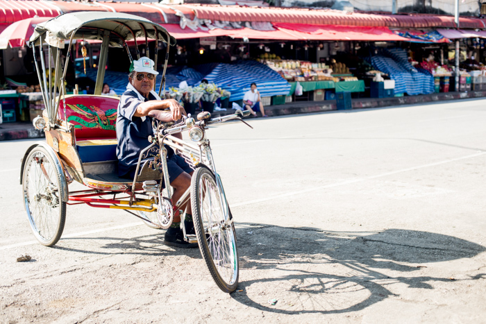 saamlor driver in a market in Chiang Mai, Thailand