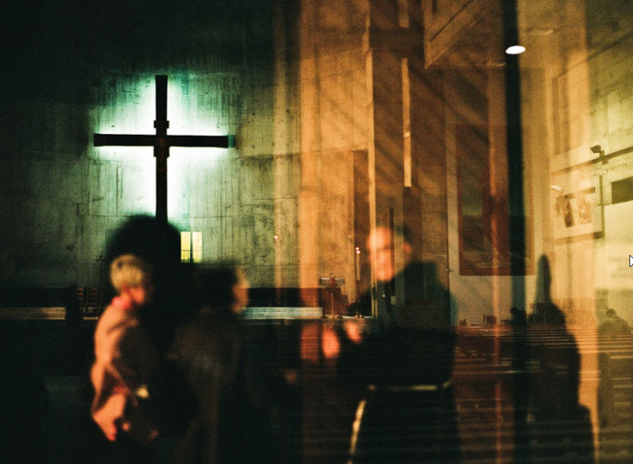 Blurred photograph of the interior of a church by Erin Grace Trieb. Famous photographers to follow.