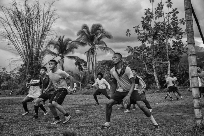 Black and white photography of men playing soccer in Cambodia by Juan Arredondo. Famous photographers to follow online