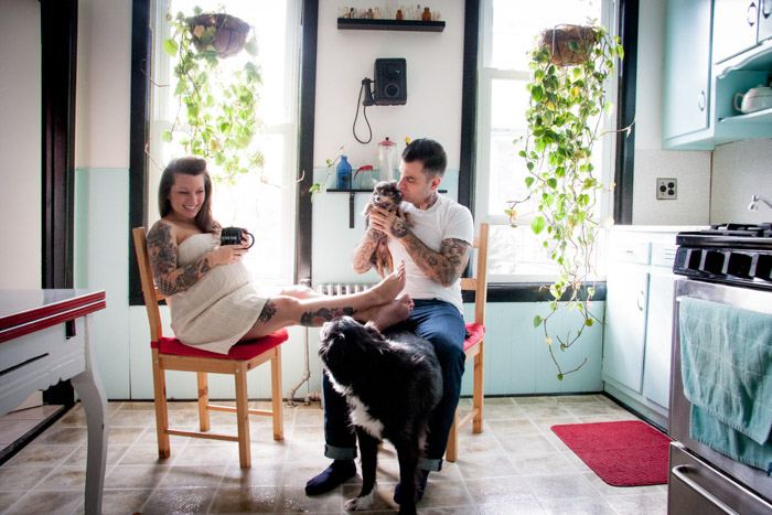 Photo of a couple with 2 dogs relaxing in the kitchen by Nina Robinson. Famous photographers to follow online