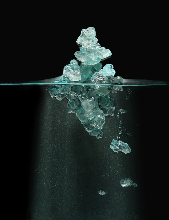 still life of blue crystals or ice in eater by Robert Clark