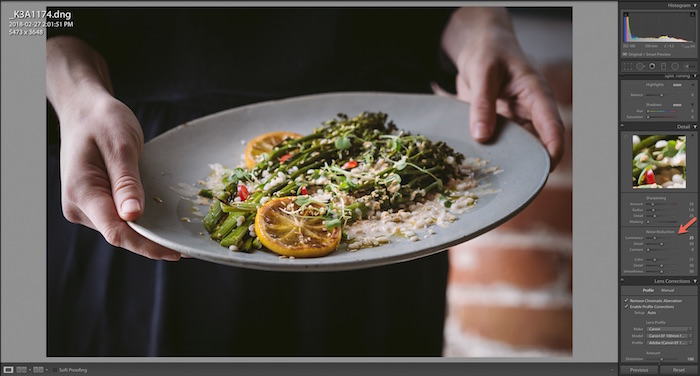 Shot of Adobe Lightroom interface editing a close up of a person holding a plate of salad. Using Lightroom for Food Photography Editing.