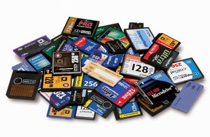 A pile of different size and type memory cards on a white background - best memory card